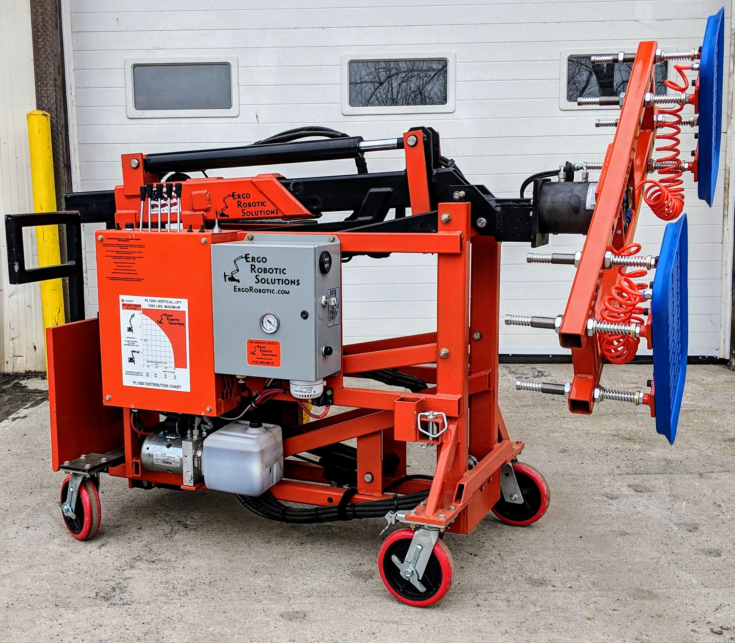 Orange Ergo Robotic Solutions Glazing Robot PL1000 with cups mounted.